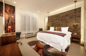 A bed or beds in a room at Elements Hotel Boutique