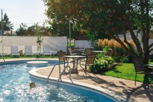 The swimming pool at or near Hotel Le Montagnais