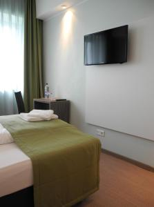 A television and/or entertainment center at Hotel Sportforum
