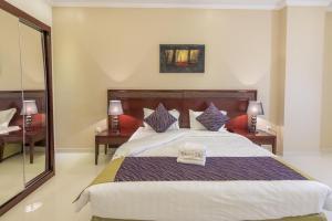 Cama ou camas em um quarto em Taleen Al Anfal ِAl Naseem Al Sharqy