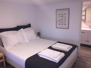 Uma cama ou camas num quarto em Quinta do Meco - Beach & Nature