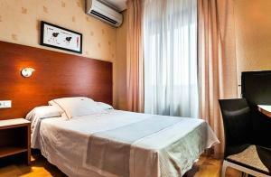 Cama o camas de una habitación en Hotel Xauen