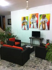 Телевизор и/или развлекательный центр в Hotel Betoma