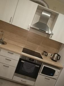 "A kitchen or kitchenette at Апартаменты ""Like Home"" на площади Ленина"