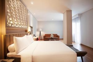 A bed or beds in a room at ibis Styles Cikarang