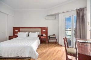 A bed or beds in a room at Attalos Hotel