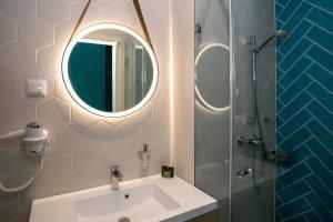 Salle de bains dans l'établissement T62 Hotel