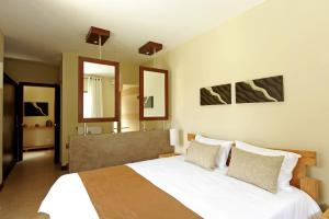 A bed or beds in a room at Athena Villas by Evaco