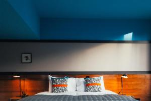 A bed or beds in a room at Bullitt Hotel