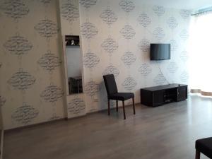 Телевизор и/или развлекательный центр в Апартаменты