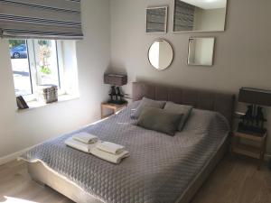 Łóżko lub łóżka w pokoju w obiekcie Willa Błękit Hotel & Restauracja by Dorota Szelągowska