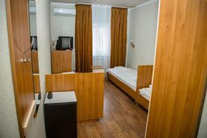 Кровать или кровати в номере Гостевой Дом Лилия