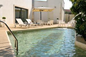 The swimming pool at or near Hotel Del Conte