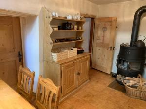 A kitchen or kitchenette at Tgesa Ferrera