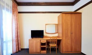 Телевизор и/или развлекательный центр в Пансионат Лад