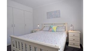 A bed or beds in a room at FANTASEA - FREE FOXTEL
