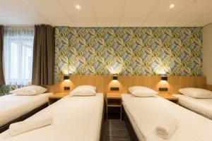 Un ou plusieurs lits dans un hébergement de l'établissement Best Western Amsterdam