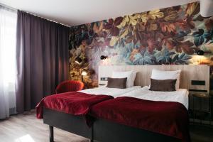 Säng eller sängar i ett rum på Best Western Kom Hotel Stockholm