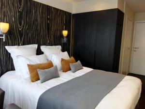 Un ou plusieurs lits dans un hébergement de l'établissement Hotel Royal