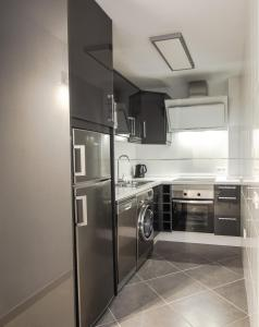 A kitchen or kitchenette at Paloma Beach Apartments