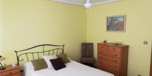 A bed or beds in a room at La Casita Camponaraya