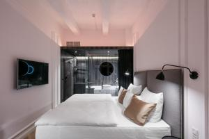 Łóżko lub łóżka w pokoju w obiekcie Pytloun Boutique Hotel Prague