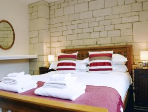 A bed or beds in a room at Lady Jane Grey