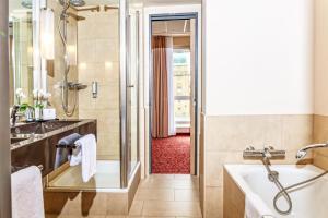 Ein Badezimmer in der Unterkunft Welcome Hotel Darmstadt