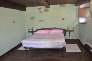 Letto o letti in una camera di Il Borgo Di Monica