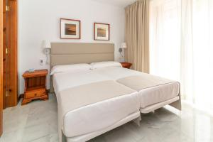 A bed or beds in a room at Parque Santiago III