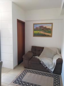 A seating area at Apartamento Cidade Verde 4