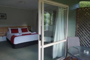 A bed or beds in a room at Abel Tasman Haven