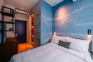 A bed or beds in a room at The Sheung Wan