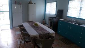 A kitchen or kitchenette at Aitutaki Budget Accommodation