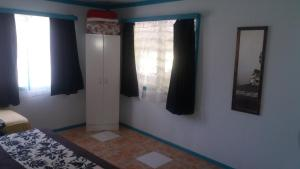 A television and/or entertainment center at Aitutaki Budget Accommodation