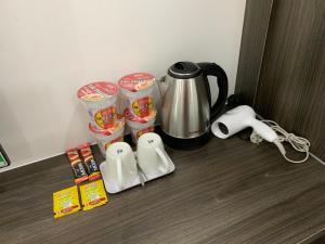 Coffee and tea-making facilities at Home Thiên Trang 3