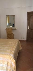 A bed or beds in a room at La Mammola