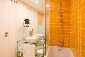 Uma casa de banho em Cerca Design House