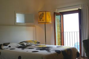 A bed or beds in a room at Villa Minuta