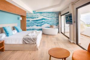 Een bed of bedden in een kamer bij Costa Calero
