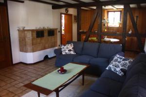 Ein Sitzbereich in der Unterkunft Ferienhaus Schilling