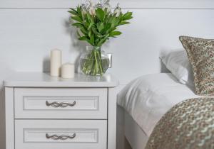 Кровать или кровати в номере Teplitsa Park