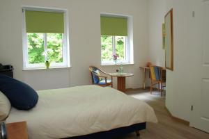 Een bed of bedden in een kamer bij Wald Villa Üssbach