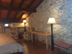 Un ou plusieurs lits dans un hébergement de l'établissement Kuko Hotel Restaurant - Adults Only
