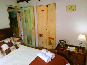 A bed or beds in a room at Sumercé Posada Pintoresca