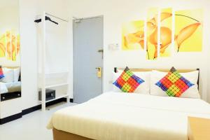 A bed or beds in a room at Kamusta Boutique Hotel