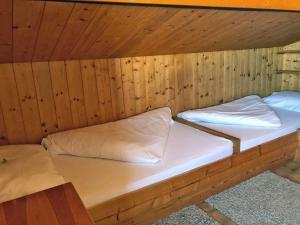 Postel nebo postele na pokoji v ubytování Chalet Maresi by Schladming-Appartements