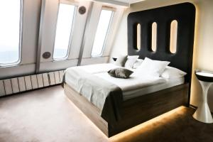 Postel nebo postele na pokoji v ubytování Hotel Ještěd