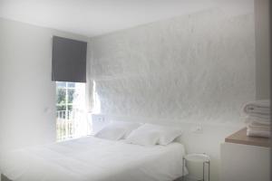 A bed or beds in a room at Quinta Milhão - Casa da Horta