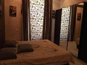 Cama ou camas em um quarto em Nizami Küçəsi Bedrooms 3